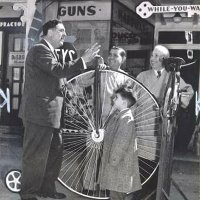 03/56 - L to R, Joe Giuffre, member and PDG from 1954 until his passing, Vince Borelli, member from 1955 to 1962, his young nephew Emil, and his father Albert Borelli. All are standing around the penny-farthing bicycle in front of Borelli Hardware and Sporting Goods, 4537 Mission St.