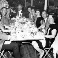 05/63 - District 4C-4 Convention, Hoberg's Resort, Lake County - Dinner time. L to R around the table: member, wife, Lion Joe and Emma Giuffre, member (opposite end of table), wife (to his left), Lion Bill Tonelli, Estelle and Lion Charlie Bottarini, and Irene Tonelli.