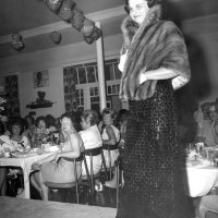 05/63 - District 4C-4 Convention, Hoberg's Resort, Lake County - Estelle Bottarini modeling a dress and fur wrap during a fashion show during the Ladies Luncheon.