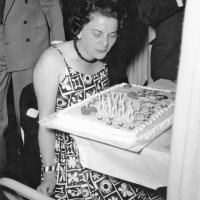 05/63 - District 4C-4 Convention, Hoberg's Resort, Lake County - Estelle Bottarini blowing out candles during her birthday celebration at the convention. Her birthday was May 26th.