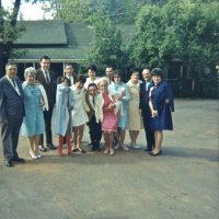 05/68 - District 4C-4 Convention, Hoberg's Resort, Lake County - Parking lot pose; rear: Lion Art Blum, Lion Charlie and Estelle Bottarini, and member. Front: Lion Joe and Emma Giuffre, daughter (?) and Maryann Blum, Lion Frank Ferrera, Linnie Faina, wife, wife, member, and Pat Ferrera.