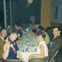 05/68 - District 4C-4 Convention, Hoberg's Resort, Lake County - Dinner time; around table from closest: Pat and Lion Frank Ferrera, Estelle and Lion Charlie Bottarini, Eva Bello, Lion Bob and Pauline Woodall, wife, and member., daughter (?), wife, member, Linnie Faina, wife, member, Lion Art and Maryann Blum.