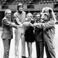 1969-70 - L to R: District Governor Fred Newman, player, guest, Charlie Bottarini (Trustee, LEF), and Lion Mascot.