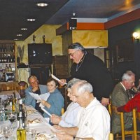 12/8/04 - Club Christmas Party, Ristorante Mar, Pacifica - Members and guests singing Christmas carols, led by Lion Handford (standing). From left: Lion Ted Wildenradt, and a guest. Opposite side, center is Lion Mike and Lorraine Castagnetto, Estelle and Lion Charlie Bottarini. Behind Lion Handford is Lion Ward and Diane Donnelly.