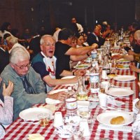 2/26/05 - Crab Feed at Recreation Center For the Handicapped, San Francisco - 429 attending - enjoying dinner; Lion Ted (hands) and Vernelle Wildenradt in lower left, and Lion Ward Donnelly two places down shouting something.