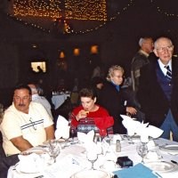 11/27/05 - 27th Annual Giulio Francesconi Charity Raffle Drawing at the Italian American Social Club - L. to R.: Guest, Lion George and Kathy Salet, Vernell and Lion Ted Wildenradt. Lion Dick Johnson walking past in the background.
