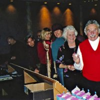 11/27/05 - 27th Annual Giulio Francesconi Charity Raffle Drawing at the Italian American Social Club - As is the custom, ticket holders are invited to choose their numbered ping pong ball and toss it in the drawing drum. Shown are two guests at the far end, and going up the line are two guests, Roxanne Gentile, guest, and John Fiore, proudly displaying his numbered ball.