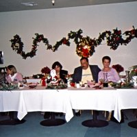 12/7/05 - Club Christmas Party at the Sharp Park Golf Course Restaurant, Pacifica - John Jones and Lion Bre Martinez, Zenaida Lawhon (her husband Lion Bob Lawhon taking the photo), Lion George and Kathy Salet, and Lion Ward Donnelly enjoying dinner.