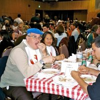 2/25/06 - 24th Annual Crab Feed at the Janet Pomeroy Center For The Handicapped - 470 attendees - Lion Aaron (blue hat) and Jesusa Straus enjoying crab with some of their guests.