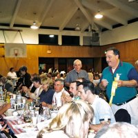 2/25/06 - 24th Annual Crab Feed at the Janet Pomeroy Center For The Handicapped - 470 attendees - Lions Charlie Bottarini and George Salet (both standing) hawking raffle tickets during dinner.