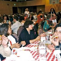 2/25/06 - 24th Annual Crab Feed at the Janet Pomeroy Center For The Handicapped - 470 attendees - Lion Aaron (blue hat) and Jesusa Straus, and Zenaida Lawhon enjoying crab with some of their guests.