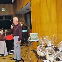 2/25/06 - 24th Annual Crab Feed at the Janet Pomeroy Center For The Handicapped - 470 attendees - Lion Ward Donnelly preparing to announce raffle winners. Some the available prizes were gift baskets prepared by Zenaida Lawhon.