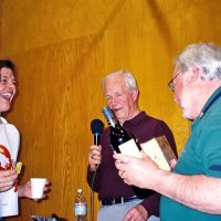 2/25/06 - 24th Annual Crab Feed at the Janet Pomeroy Center For The Handicapped - 470 attendees - Roxanne Gentile is the lucky winner of a box of candy and a nice bottle of wine. Lion Ward Donnelly announcing and Lion Bob Lawhon presenting the prize.