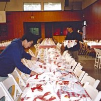 2/25/06 - 24th Annual Crab Feed at the Janet Pomeroy Center For The Handicapped - 470 attendees - Members of the Lowell High School Leos helping to set tables before the event.