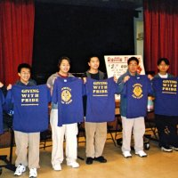 2/25/06 - 24th Annual Crab Feed at the Janet Pomeroy Center For The Handicapped - 470 attendees - Six members of the Lowell High School Leos proudly displaying their shirts after helping to set tables for the event. Lion Handford, ticket chairman, is seated on the far right.