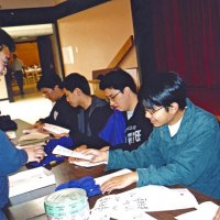 2/25/06 - 24th Annual Crab Feed at the Janet Pomeroy Center For The Handicapped - 470 attendees - Member of the Lowell High School Leos folding brochures to be handed out at the event.