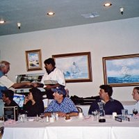 8/17/05 - Sharp Park Golf Course, Pacifica - Lion Chairman Bob Fenech (out of picture) commenting about the tournament. Standing: Lion Dick Johnson. Seated: Lion Ernie Braun, guest, Leona Wong, guest, John Jones, and Lion Bre Martinez.