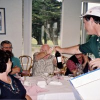 8/17/05 - Sharp Park Golf Course, Pacifica - Lion Chairman Bob Fenech handing a prize to a raffle winner.