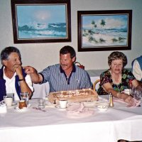 8/17/05 - Sharp Park Golf Course, Pacifica - A birthday boy with a surprise cake. Seated: guest, birthday boy, Laverne Cheso, and Lion Dick Johnson.