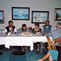 8/17/05 - Sharp Park Golf Course, Pacifica - Blowing out the candles enjoyed by Lion Bre Martinez, guest, birthday boy, Laverne Cheso, Lion Dick Johnson, guest, Pat Bell, Lion Charlie Bottarini and another guest (facing away from camera).