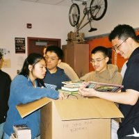 3/29/06 - Lowell Leo Club members unpacking and preparing donated books for Some Book Buddies.
