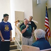 12/12/05 - Lowell Leo Club at Coventry Presbyterian Church - Lowell Leo Club members with Lion Bob Lawhon (with mic), and David Brown, on his left, talking with guests about the Coventry Food Pantry.