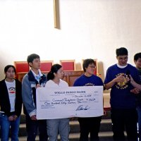 12/12/05 - Lowell Leo Club at Coventry Presbyterian Church - Lowell Leo Club members presenting a $150 donation to the Coventry Food Pantry. Lion Bob Lawhon is on the far right.