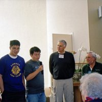 12/12/05 - Lowell Leo Club at Coventry Presbyterian Church - A Leo member making comments about their donation. David Brown, with Coventry Food Pantry, and Lion Bob Lawhon are on the far right.