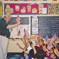 2/17/06 - Flag Day Program at Mission Educational Center for 211 students - Lion Bob Lawhon getting a rise from students as he talks about the flag.