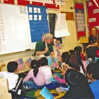 2/17/06 - Flag Day Program at Mission Educational Center for 211 students - Lion Bob Lawhon getting down close to the students while he talks about the flag.