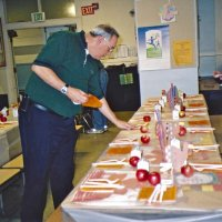 11/22/05 - Mission Educational Center, San Francisco - Lions Aaron Straus and Bre Martinez working on table settings.