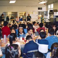 11/22/05 - Mission Educational Center, San Francisco - Students and teachers wait patiently for their lunch to be served. Across the back are Lions Sheriar Irani, Al Gentile, Joe Farrah, Bre Martinez, cafeteria staff, Lyle Workman, and Aaron Straus work out the details.