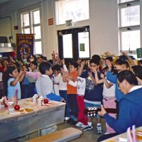 11/22/05 - Mission Educational Center, San Francisco - Students singing one of their songs with their teacher playing the guitar. Lots of motion in many of the songs.