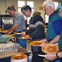 11/22/05 - Mission Educational Center, San Francisco - Lions Lyle Workman, Sheriar Irani, Al Gentile, and Joe Farrah waiting for the plates to be dished before serving the students.