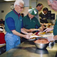 11/22/05 - Mission Educational Center, San Francisco - Lions Al Gentile, Joe Farrah, Lyle Workman, and Sheriar Irani circling around for another handful of plates to serve while Lion Aaron Straus dishes up cranberry sauce.