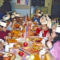 11/22/05 - Mission Educational Center, San Francisco - Students enjoying their lunch of turkey, stuffing, sweet potatoes, carrots, and cranberry sauce.