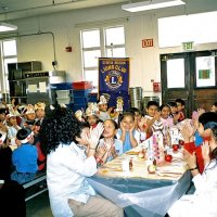 11/22/05 - Mission Educational Center, San Francisco - Another song, just before lunch. Standing, Lion Aaron Straus looks on from the left, while Deborah Molof, principal, looks on from the right.