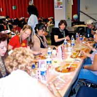 11/22/05 - Mission Educational Center, San Francisco - Teaches and principal Deborah Molof (center with black dress) enjoying their lunch.