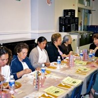 11/22/05 - Mission Educational Center, San Francisco - Visitors and principal Deborah Molof (head of table) enjoying lunch and discussing the event.