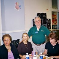 11/22/05 - Mission Educational Center, San Francisco - Lion Bob Lawhon (standing) stopping to pose with principal Deborah Molof (on his left) and visitors.