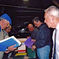 12/15/05 - MEC Christmas at Lion Charlie Bottarini's basement on Moscow St. - l. to r.: Lions Aaron Straus (chairman), Joe Farrah, Bill Graziano, Bob Fenech, and Ward Donnelly stuffing gift bags to be distributed to students at the next day's Christmas Party at the Mission Educational Center.