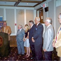 7/30/05 - United Irish Cultural Center - 55th Installation of Officers - Lion PDG Bob Marshall, at podium, installing the Club officers. Lions Bob Lawhon, Bre Martinez, Handford Clews, Dick Johnson, Ward Donnelly, and Aaron Straus.