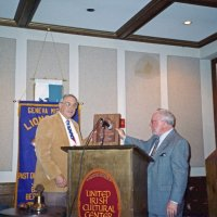 7/30/05 - United Irish Cultural Center - 55th Installation of Officers - Lion Aaron Straus presenting Lion Bob Lawhon with his Past President's plaque. Lion Bob is the second president to serve back-to-back terms. In fact, he would go on to serve a third consecutive term.