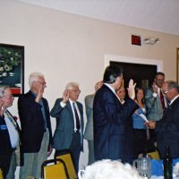8/2/06 - 56th Installation of Officers at the Italian American Social Club - Along wall: Lions Handford Clews, Bob Lawhon, Al Gentile, Galdo Pavini, Bill Graziano, Charlie Bottarini, Bre Jones, Lyle Workman, Joe Farrah, Emily Palmer, George Salet. Forward: Lions Bob Fenech, PDG Art Pignati.