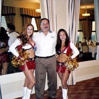 10/17/06 - 49er Night at the Cliff House - Lion George Salet happily poses with Gold Rush Cheerleaders Amy and Krissie.