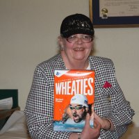 8/16/17 - 68th Installation of Officers, Sharp Park Restaurant, Pacifica - Lion Sharon Eberhardt with her box of Wheaties to give her strength for the coming year.