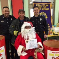 12/21/17 - Christmas with Santa, Mission Educational Center - Santa and his San Francisco Firemen escort, from the SFFD Toys for Tots Program, after receiving his certificate of thanks from the Geneva-Excelsior Lions Club.