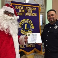 12/21/17 - Christmas with Santa, Mission Educational Center - Santa and one of his San Francisco Fireman escorts, from the SFFD Toys for Tots Program, with his certificate of thanks from the Geneva-Excelsior Lions Club.