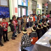 11/16/17 - Serving Thanksgiving Luncheon, Mission Educational Center - One of the classrooms entertaining the group and volunteers.