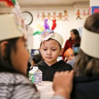 11/16/17 - Serving Thanksgiving Luncheon, Mission Educational Center - Immigrant students wait for lunch to be served at their first Thansgiving at Mission Education Center. (Mira Laing/Special to S.F. Examiner)